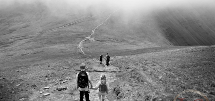 family walking down cribyn towards pen y fan